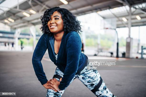 obese woman exercising outdoors - chubby stock pictures, royalty-free photos & images
