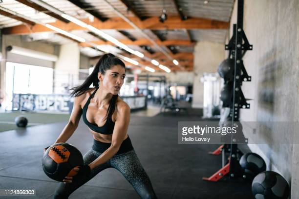 woman exercising wall ball - crossfit stock pictures, royalty-free photos & images