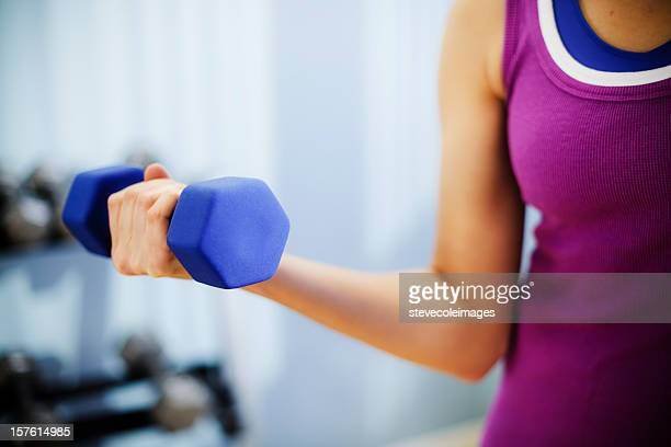 Woman Exercising With a Dumbbell