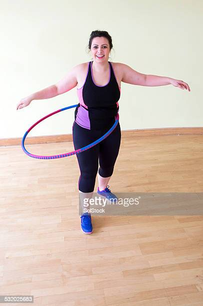 woman exercising with a hula hoop - big fat white women stock pictures, royalty-free photos & images
