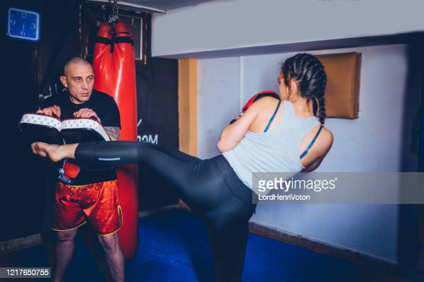 woman exercising with a trainer - punching stock pictures, royalty-free photos & images