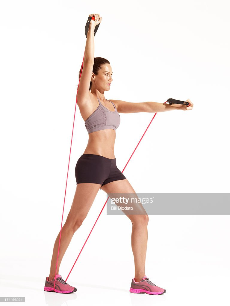 woman exercising with resistance : Stock Photo