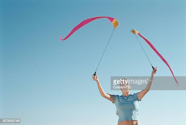 woman exercising with ribbons - vcg stock pictures, royalty-free photos & images