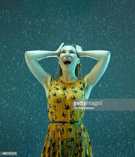 A Woman exhilarated in the rain