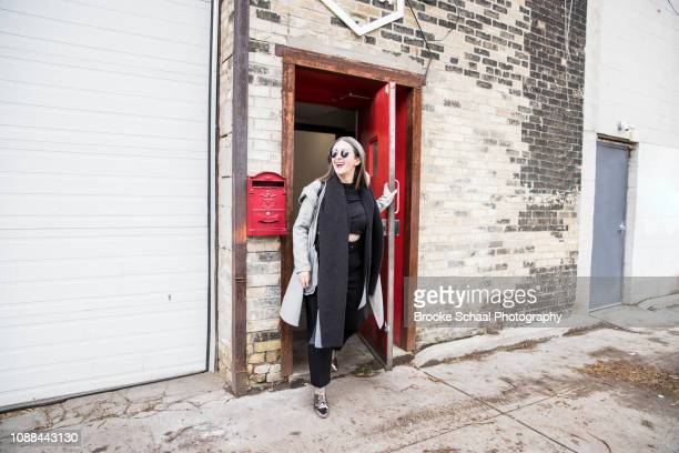 woman exiting a building - disembarking stock pictures, royalty-free photos & images