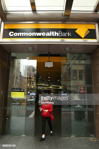 A woman exits a Commonwealth Bank of Australia branch in Sydney Australia on Monday Feb 10 2014 Commonwealth Bank Australia's largest lender is...