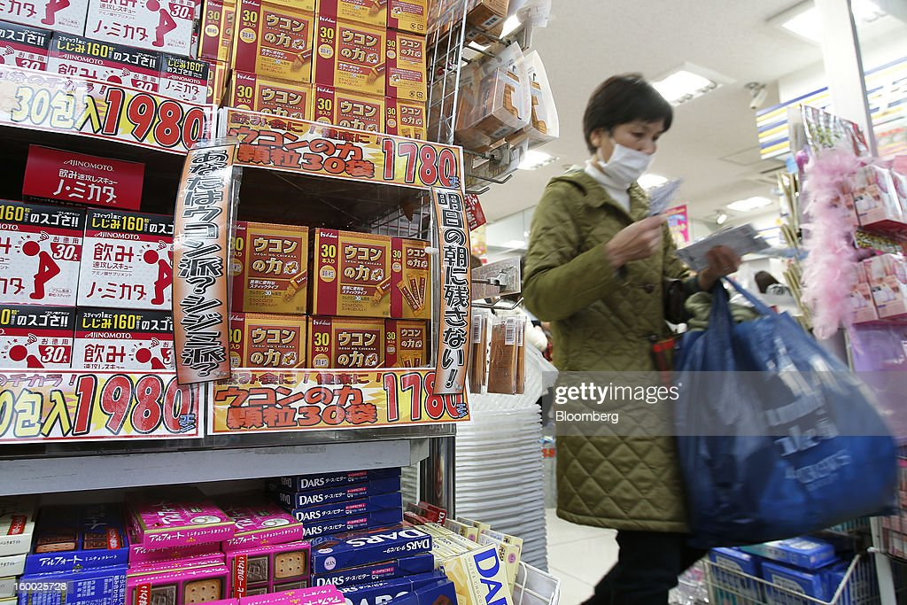 A woman exits a drugstore in Tokyo, Japan, on Friday, Jan. 25, 2013. Japan's consumer prices fell for the seventh time in eight months, underscoring the risk that the central bank may struggle to reach a 2 percent inflation target unless it implements new easing measures earlier than planned. Photographer: Kiyoshi Ota/Bloomberg via Getty Images