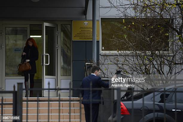 Woman exits building of the Federal state budgetary institution 'Federal Scientific Center of Physical Culture and Sport' which houses the Moscow...