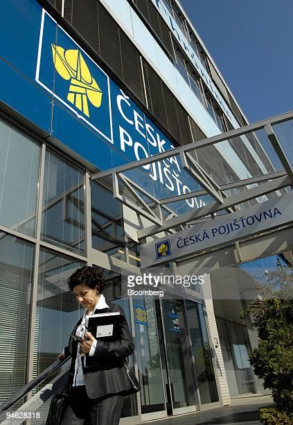 Woman exits headquarters of the Ceska Pojistovna in Prague, Czech Republic, Wednesday, April 25, 2006. Assicurazioni Generali SpA, Italy's biggest...