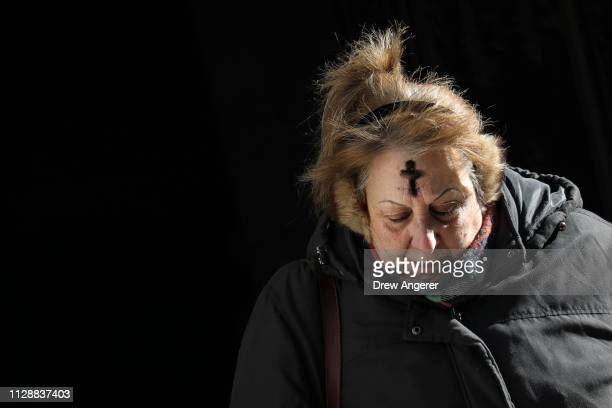A woman exits St Patrick's Cathedral after receiving a cross of black ashes on her head for Ash Wednesday March 6 2019 in New York City Ash Wednesday...