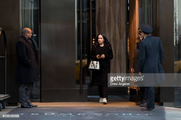 A woman exits the Trump SoHo hotel condominium building February 21 2017 in New York City The development of Trump SoHo completed in 2010 was...