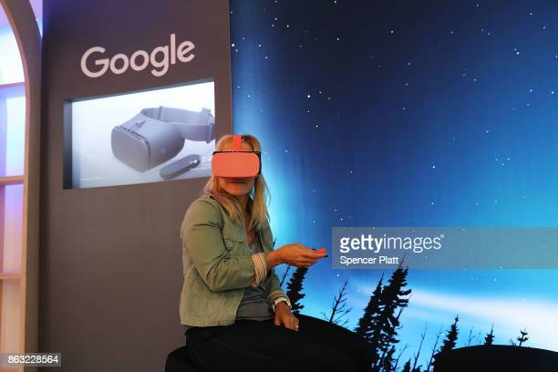 A woman experiences Google's new Daydream View VR headset at a New York City popup shop on October 19 2017 in New York City The temporary store in...