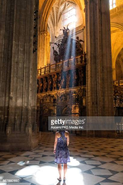 Woman explores historic architecture, spiritual setting