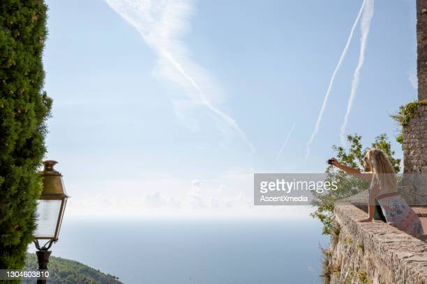 woman explores old town in french riviera - alpes maritimes stock pictures, royalty-free photos & images