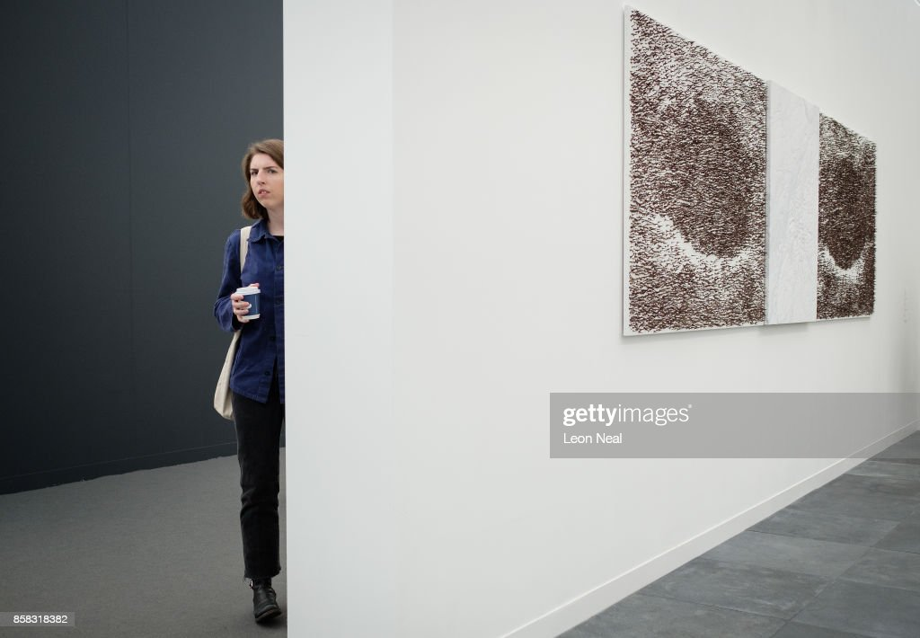 A woman explores the galleries at the Frieze Art Fair on October 6, 2017 in London, England. The annual event sees galleries showcase work by thousands of artists from around the world. The Frieze Art Fair runs from 5-8 October, 2017.