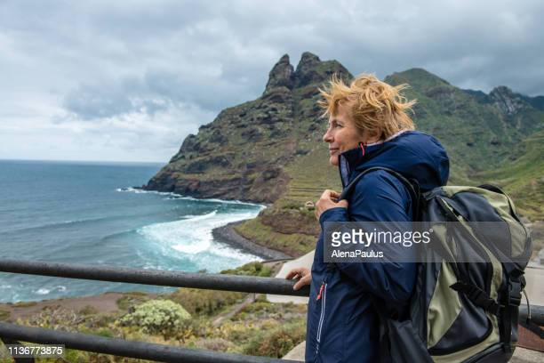 woman exploring a beautiful island - pilgrimage stock pictures, royalty-free photos & images