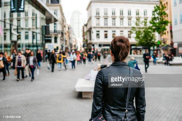 woman exploring brussels - rear view stock pictures, royalty-free photos & images
