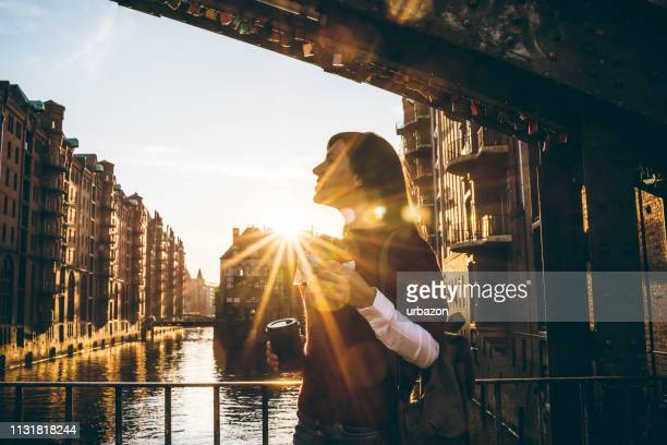 woman exploring hamburg old town - hamburg germany stock pictures, royalty-free photos & images