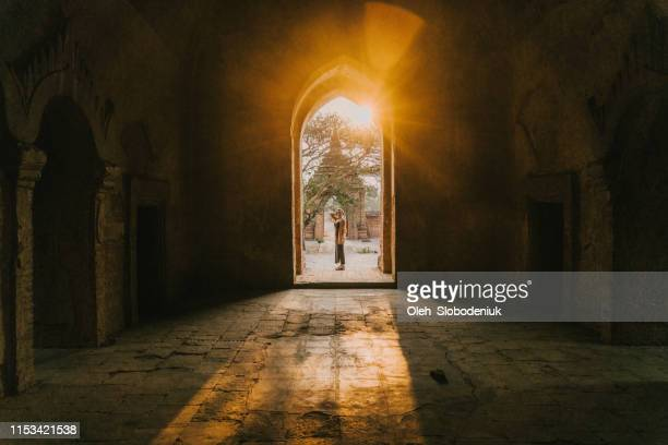 woman exploring in bagan heritage site at sunset - cambodia stock pictures, royalty-free photos & images