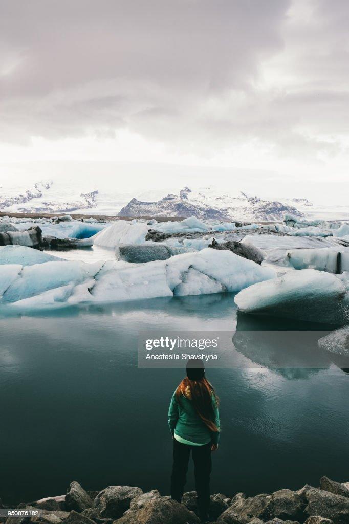 Woman exploring Jokulsarlon glacier lagoon in Iceland : Stock Photo