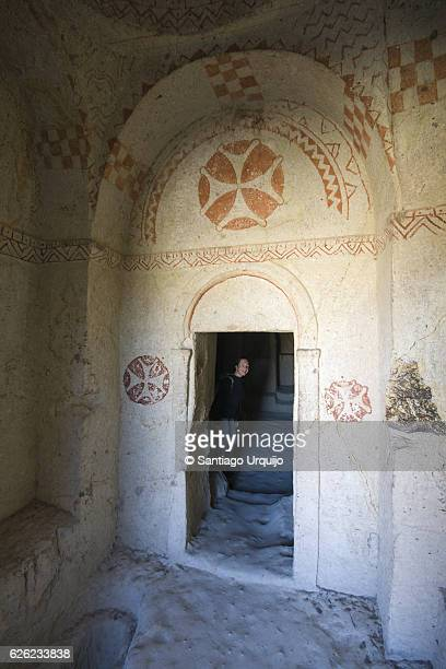 woman exploring yemekhane cave church - maltese cross stock photos and pictures