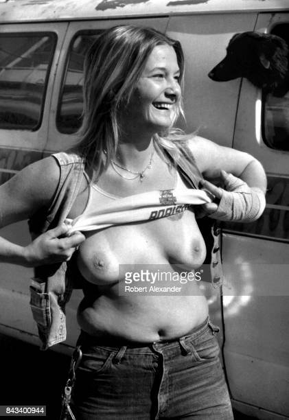 A woman exposes her breasts in Daytona Beach Florida during the city's 1983 Bike Week The annual motorcycle event and rally has attracted...
