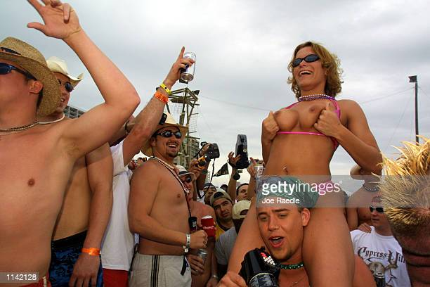 A woman exposes her breasts on the beach at South Padre Island Texas March 16 2001 during the annual rite of Spring Break Some 125000 revelers mostly...
