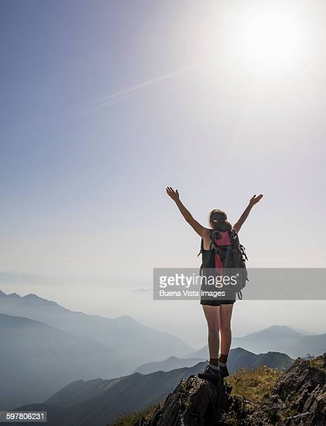 Woman exulting on a mountaintop