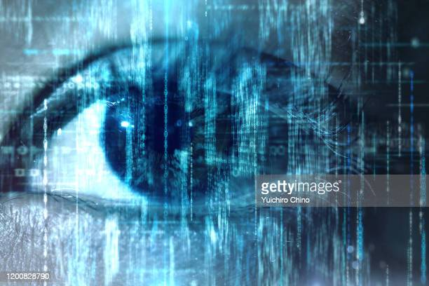 woman eye taking in digital binary data - surveillance stock pictures, royalty-free photos & images