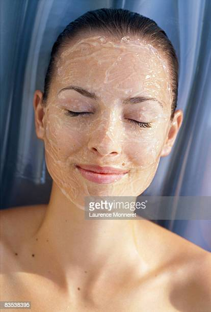 Woman eyes closed with cosmetic jelly over face