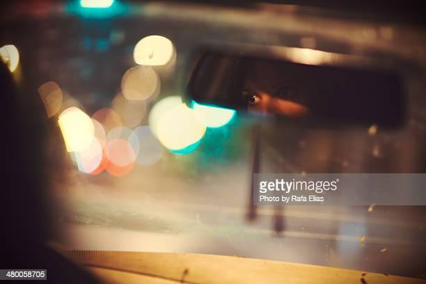 woman eyes reflected in rear mirror of car - junge frau allein stock-fotos und bilder