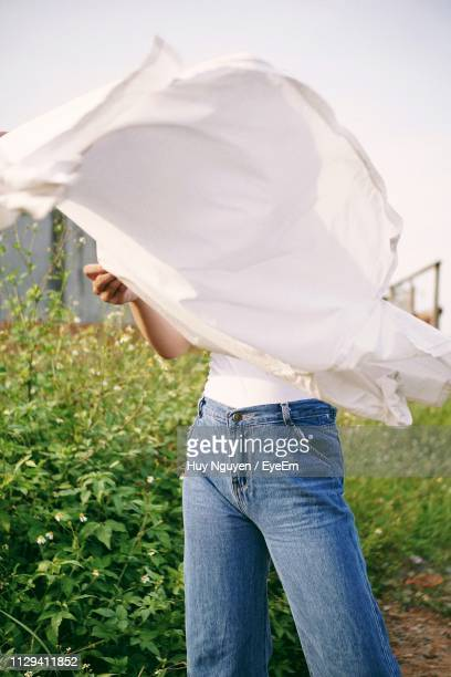 Woman Face Covered With White Scarf On Field