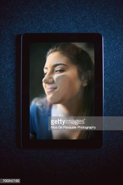 woman face squashed on digital tablet - nico de pasquale photography stock pictures, royalty-free photos & images