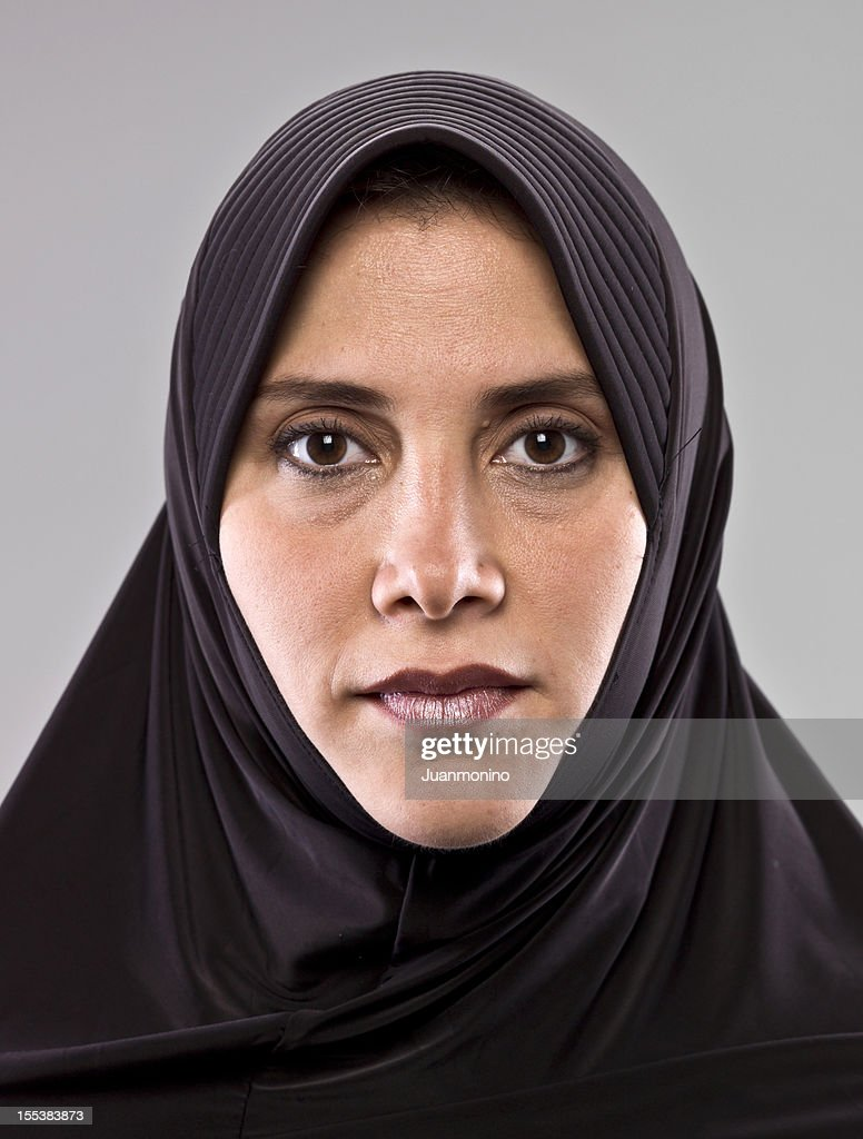 Woman facing forward with serious expression. : Stock Photo