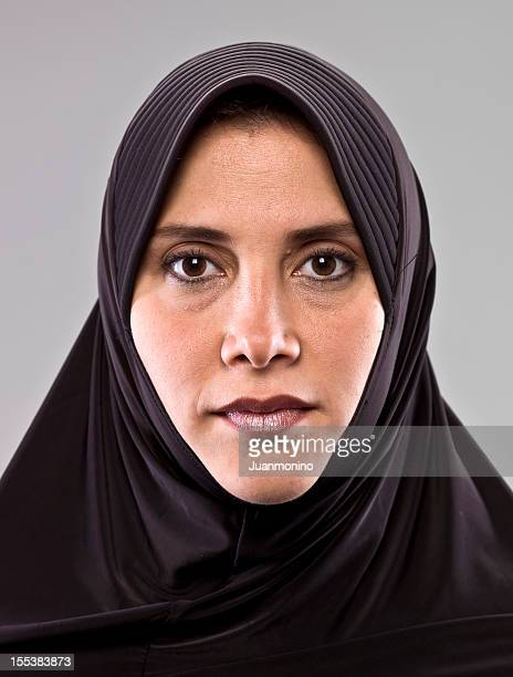 Woman facing forward with serious expression.