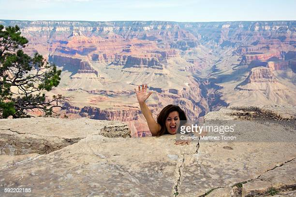 Woman falling from the rock in Grand Canyon.