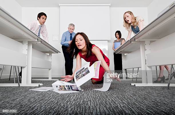 woman falling scattering documents
