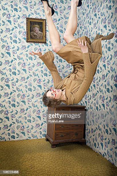 woman falls from the ceiling of her vintage living room - upside down stock pictures, royalty-free photos & images