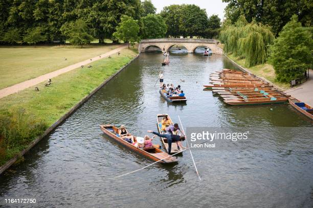 A woman falls into the River Cam after a crash between traditional punts on July 25 2019 in Cambridge United Kingdom The Met Office issued a weather...