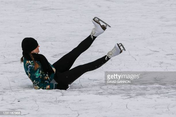 Woman falls while ice-skating on the frozen Landwehr Canal in Berlin's Kreuzberg district on February 15, 2021.