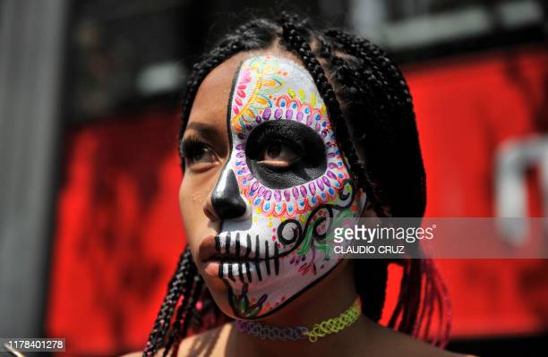 A woman fancy dressed as Catrina takes part in the Catrinas Parade along Reforma Avenue in Mexico City on October 26 2019 Mexicans get ready to...