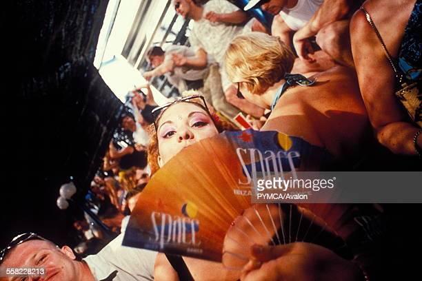 Woman fanning herself, Space, Ibiza, 1999.