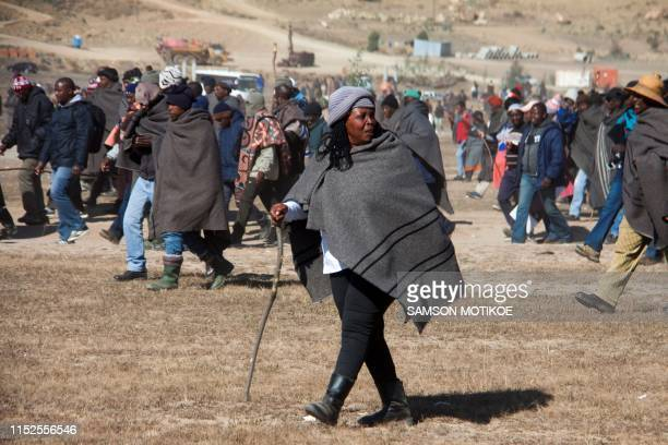 Woman farmer takes part in a march to parliament as farmers protest against regulations forcing them to sell their wool and mohair to a Chinese...