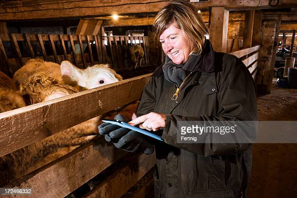 Woman farmer using a tablet computer
