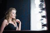 woman fashion model near mirror dressing