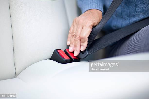Woman fastening seatbelt