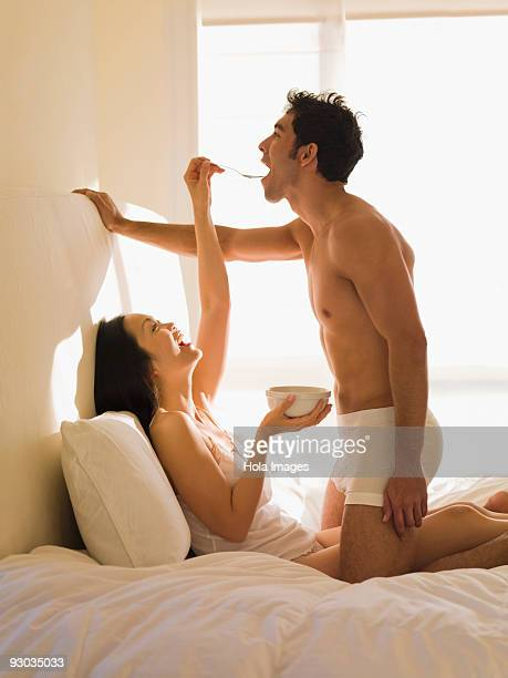 Woman feeding cereal to a man