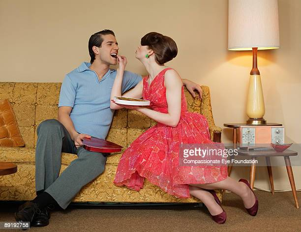 woman feeding man chocolates  - couple chocolate stock pictures, royalty-free photos & images