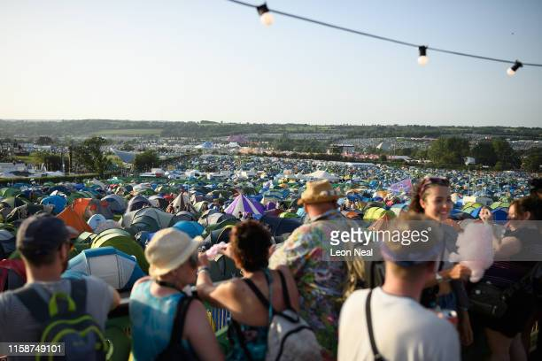 A woman feeds candy floss to her friend as they enjoy the evening sun from the newlyunveiled GlastonburyOnSea area on day two of Glastonbury Festival...