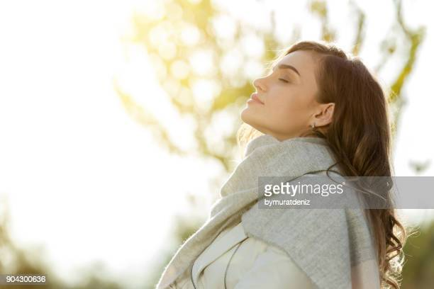 woman feeling autumn - tranquility stock pictures, royalty-free photos & images